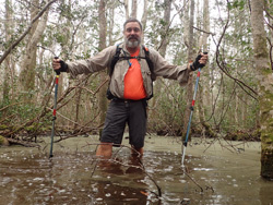 Andy Niekamp hiking in deep water in Florida